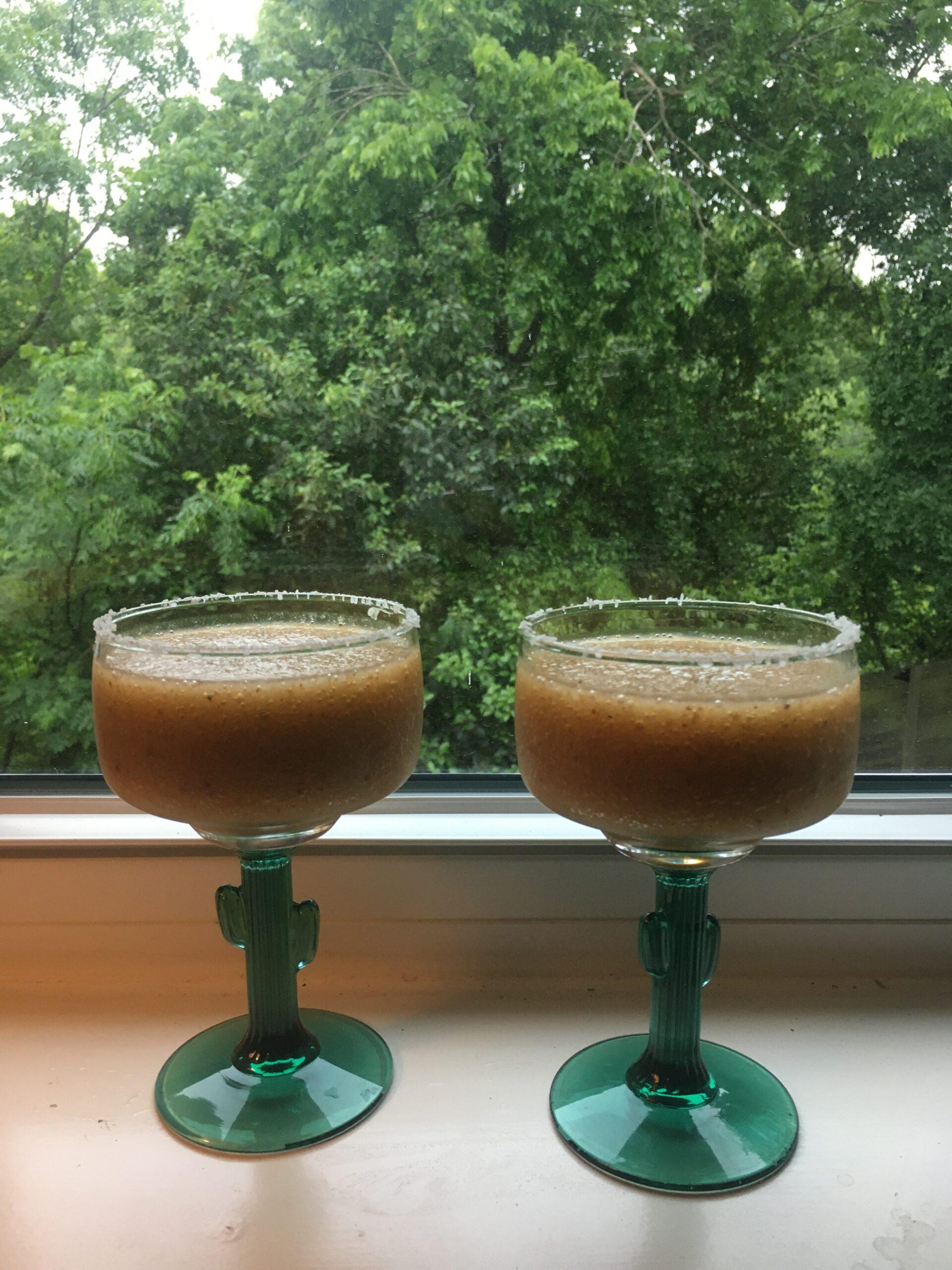 two loquatritas on a windowsill